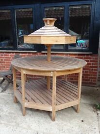Circular wooden display stand. Suitable for a shop or farm shop.