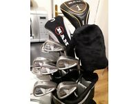 Set of clubs with bag and pull trolley for sale.