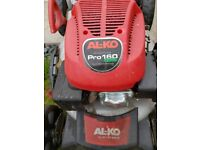 Alko petrol lawn mower with drive system and quick start including grass box and accessories