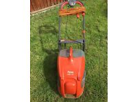 Flymo Glider 350..Only used a handful of times. Power cord, grass collecting box.