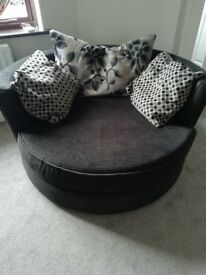 DFS circular 2 seater arm chair.
