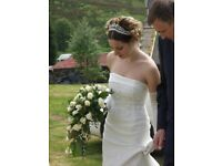 Beautiful ivory fishtail wedding dress with embroidery detailing