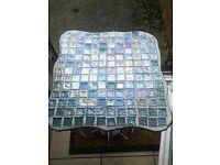 Turqoise mosaik table with wine bottle holders