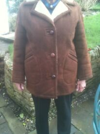 Ladies SHEEPSKIN COAT classic style size 14. Ideal for this weather.