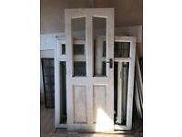 Wooden door with window panels (was used as back door)