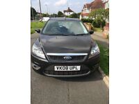 Black Ford Focus Zetec Climate 2008.