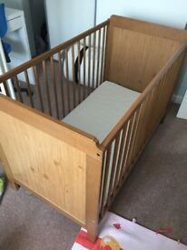 Ikea Baby Cot with mattress.