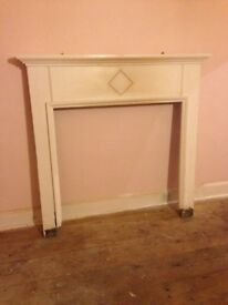 Solid wood fire surround. I have two of these - can be sold together or separately.