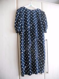 Navy blue and white spotted dress size 14-16 from Sporting