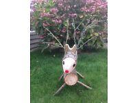 Hand made log reindeer