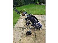 Junior golf clubs and trolley