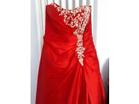 Red formal occasion dress designed by designed by sousourada