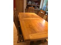 Solid extendable oak dining table & 6 chairs
