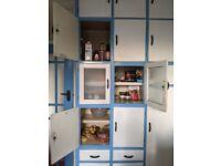 Retro original kitchen cupboards with bakelite handles