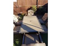 **Virtually new**wood effect garden table and 6 chairs with cushions, umbrella and base