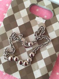 DKNY silver necklace.