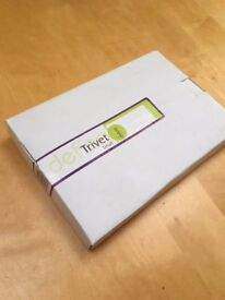 Set of four metal trivets. Attractive design, suitable for table. Brand new, in original packaging