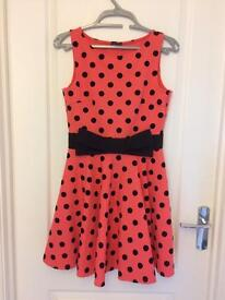 Coral and black spot dress