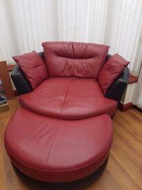 DFS Leather swivel armchair