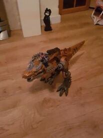 Transformers toys in good condition. Grimlock worth about £45 on its own.