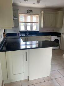 Full Kitchen with black granite work top
