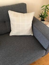 Beige/sandy cushion with white check