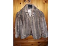 Brown faux fur jacket size 14 in good condition. Barely worn.