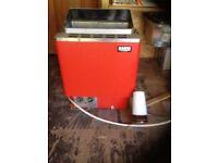 Finish Sauna stove with coals water bucket and ladle , plus sauna light.