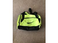 Neon yellow Nike duffle bag