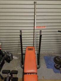 Weights bench, barbell and dumbell bars.