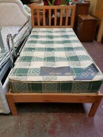 Wooden single bed frame with orthopaedic mattress