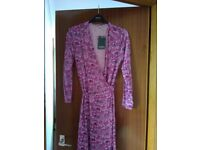 Pink cherokee floral wrap over dress never been worn brand new