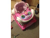 Girls baby walker hardly used in good condition