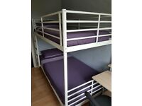 Ikea bunk bed with two mattresses, single size.