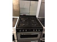 NEWWORLD free standing full gas cooker 60 cm width black & silver in good condition perfect working