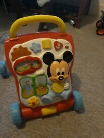 Neatly used mickey mouse Vtech baby walker