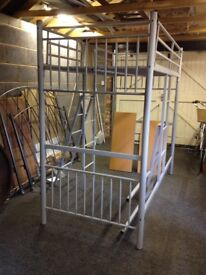 Woodlake metal bunk bed and work station for sale.
