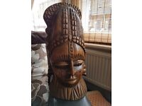 Carved wood double sided/faced statue.