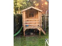 Child wooden log cabin with slide