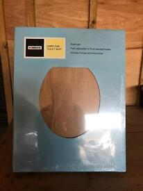 Solid wood toilet seat brand new unopened