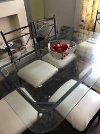 Glass top wrought iron table not with chairs