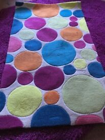 Rug 80x140cm cream background with coloured circles - stylish and fun. Bought from john lewis.