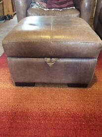 Brown leather storage pouffe