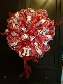 Beautifully handcrafted red and white snowman decomesh wreath