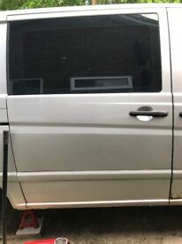 Used Mercedes Vito w639 bare drivers rear sliding door with glass in silver