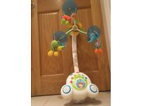 Musical mobile for baby, attaches to cot.