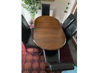 Black Wooden dinner table of 6 leather chairs