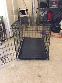 Dog cage, hardly used.