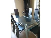 Dining Room Furniture. 2 Black corner display units, Glass table, 6 Black chairs, 1 Drinks Cabinet