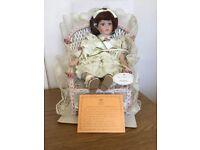 Leonardo porcelain doll . (. MADDIE in chair )